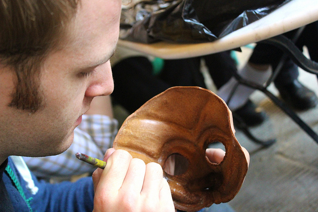 MFA Student works on his leather mask