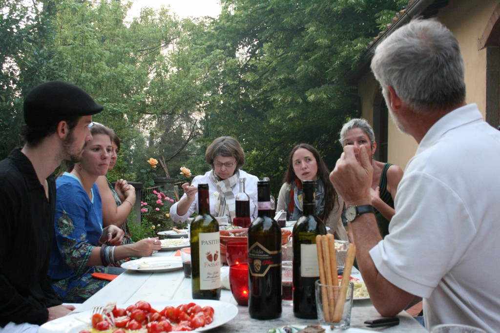 Faculty and staff of the Accademia dell'Arte enjoy a lively discussion over Tuscan wine
